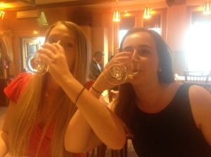 Jackie and I attempting to drink our wine the proper way.